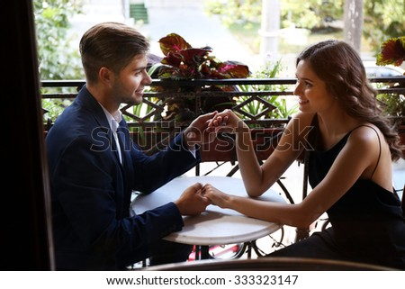 Happy couple flirting at terrace - stock photo