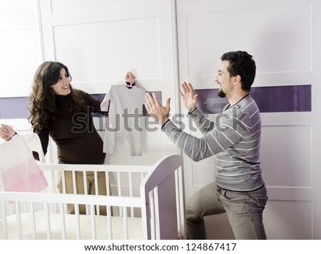 Happy couple for new life preparing the nest - stock photo