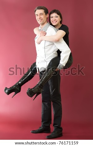 Happy couple games on red burgundy background - stock photo