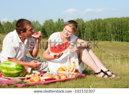 happy couple have picnic outdoor - stock photo