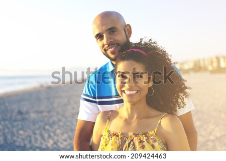 Happy couple having a good time at the beach in the summer sunset.Vintage retro style with soft focus and sun flare .Sunbeams. Enjoyment.  - stock photo