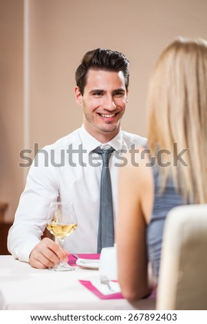 Happy couple having a great time at the restaurant - stock photo