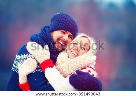 happy couple having fun during winter holiday - stock photo