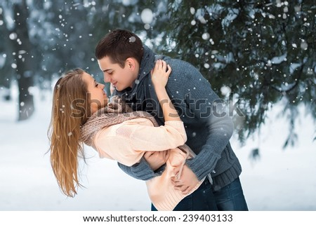 Happy Couple Having Fun Outdoors. Snow. Winter Vacation. Outdoor - stock photo