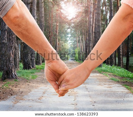 Happy couple holding hands - stock photo