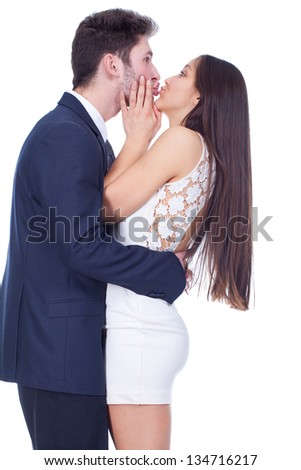 Happy couple hugging and kissing - stock photo