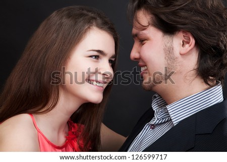 Happy couple hugging and looking at each other. Valentine�¢??s day - stock photo