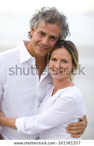 Happy couple hugging and smiling. - stock photo