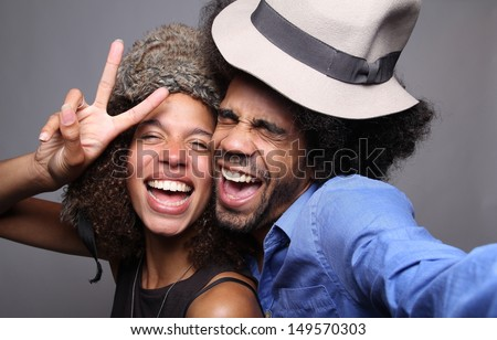 Happy couple in a photo booth - stock photo