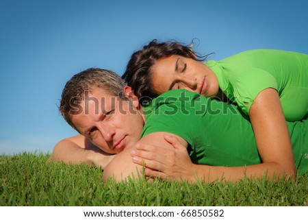 happy couple in love outdoors in summer - stock photo