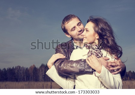 Happy Couple in Love . Sensual outdoor portrait of young stylish fashion  - stock photo