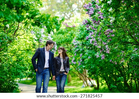 Happy couple in love walking at alley - stock photo