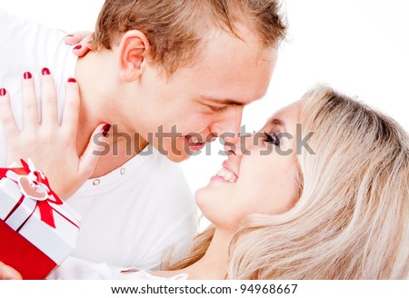 Happy couple in love with a present for Valentines Day - isolated - stock photo