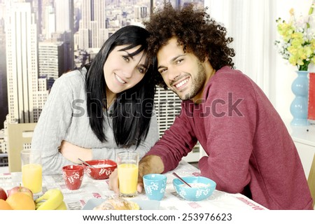 Happy couple in love with cereals fruit and coffee - stock photo