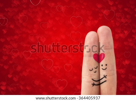 Happy couple in love with painted smiley  - stock photo