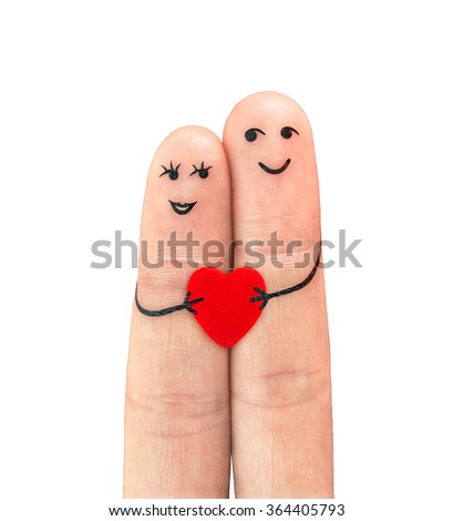 Happy couple in love with painted smiley holding red heart - stock photo