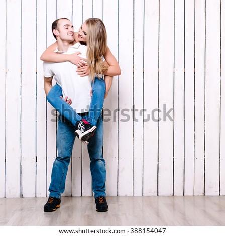 Happy couple in love. Woman embrace her boyfriend. - stock photo