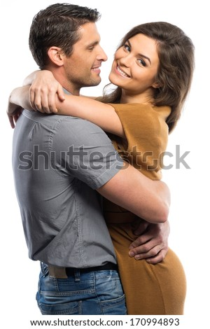 Happy couple in shirt and dress hugging isolated on white  - stock photo