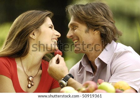 Happy couple in the garden - stock photo