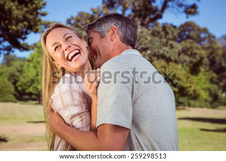 Happy couple in the park on a sunny day - stock photo