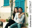 Happy couple in the small italian city, retro style - stock photo