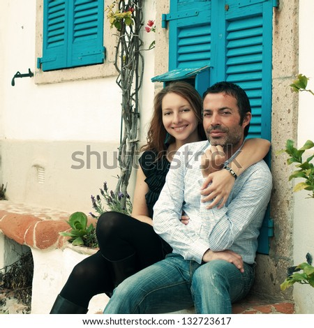 Happy couple in the small italian city, retro style - stock photo