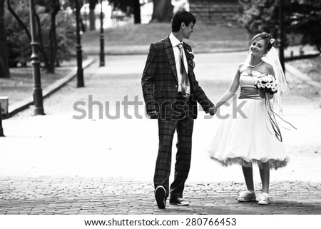happy couple is walking on  background park - stock photo