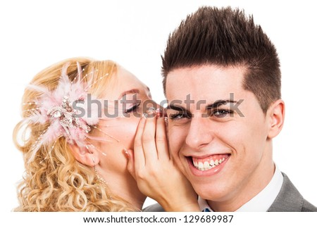 Happy couple laughing and whispering, isolated on white background. - stock photo