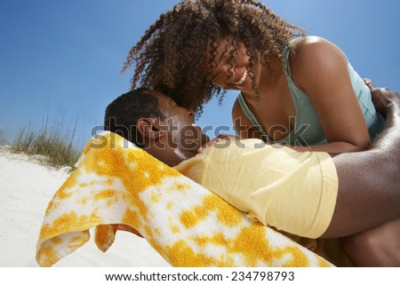 Happy Couple Laughing at Beach - stock photo