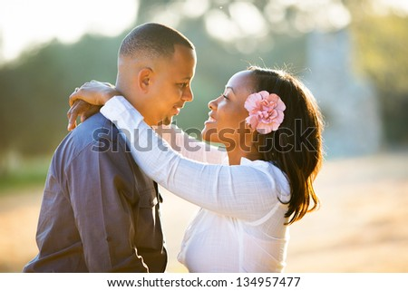 Happy couple looking into each others eyes - stock photo