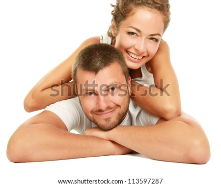 Happy couple lying on floor and smiling at camera isolated on white background - stock photo