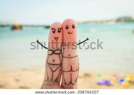 Happy couple. Man and woman have a rest on the beach in bathing suits.  - stock photo