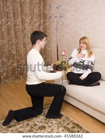 Happy couple. Man is giving gifts woman at Valentine?s day.  Male say happy birthday to female. - stock photo