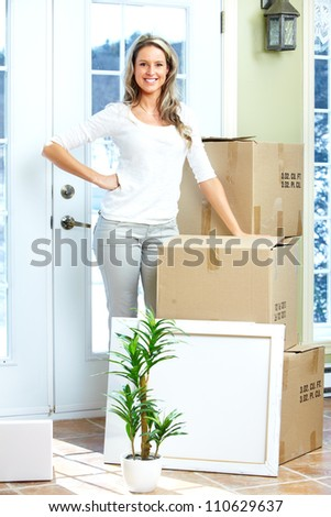 Happy couple moving in a new house. Real estate. - stock photo