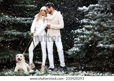 Happy couple near a tree. Christmas Eve. - stock photo