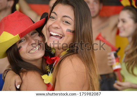 Happy couple of girlfriends sport soccer fans celebrating. - stock photo