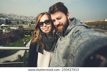 Happy couple of young tourists makes selfie photo in Istanbul, Turkey - stock photo