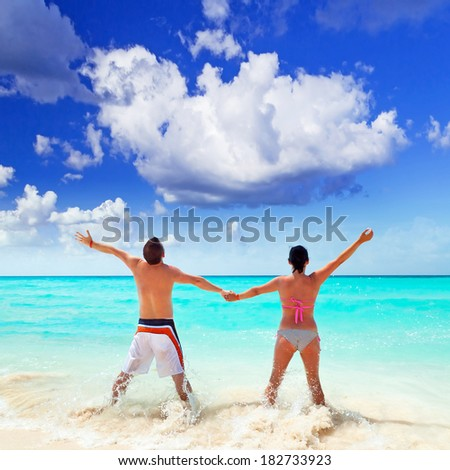 Happy couple on holidays at Caribbean Sea - stock photo