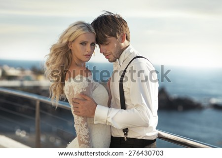 Happy couple on sea-coast - stock photo
