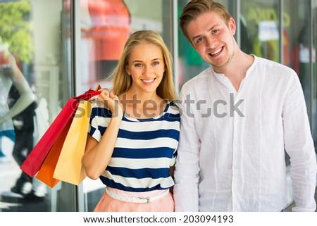Happy couple on shopping - stock photo