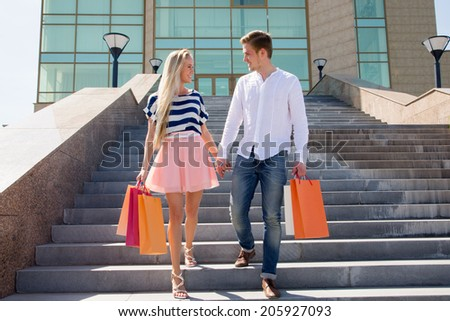 Happy couple on shopping - stock photo