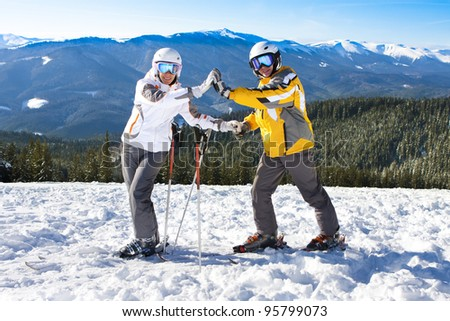 happy couple on ski vacation - stock photo