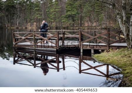 Happy couple on the bridge - stock photo
