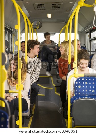 Happy couple on the bus - stock photo