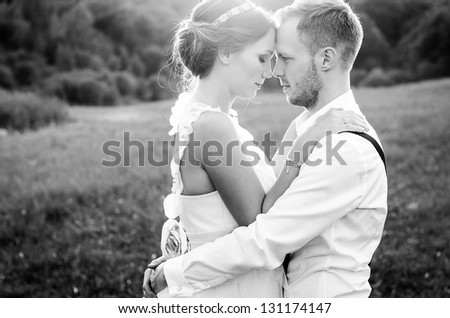 Happy couple on wedding day. Bride and Groom. - stock photo