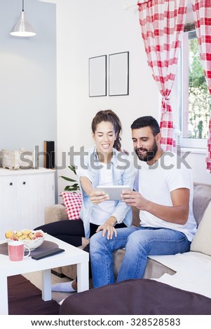 Happy couple packing cardboard boxes moving to new house Shallow depth of field - stock photo