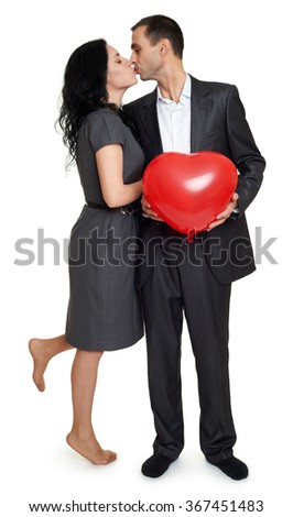 Happy couple portrait dressed in classic clothes, man hold red heart shaped balloon, valentine holiday concept - stock photo