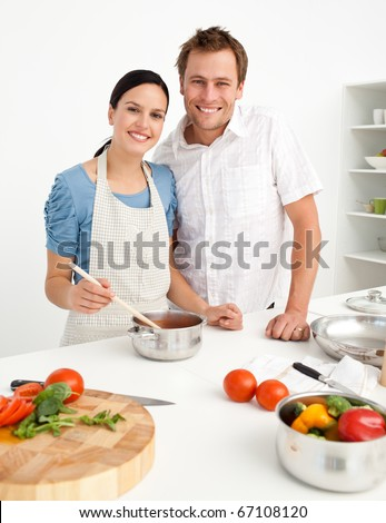 Happy couple preparing a bolognese sauce together - stock photo