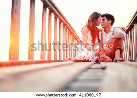 Happy couple relaxing and smile on the wood bridge  - stock photo