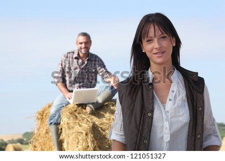 happy couple relaxing in their farm - stock photo